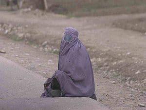 A female beggar in Afghanistan, wearing a burka