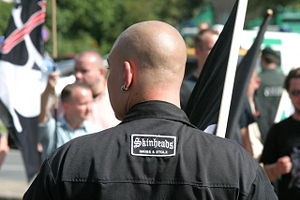 Neo-nazi skinhead with a patch in German that ...