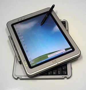 Photo of HP Tablet PC running MS Windows Table...